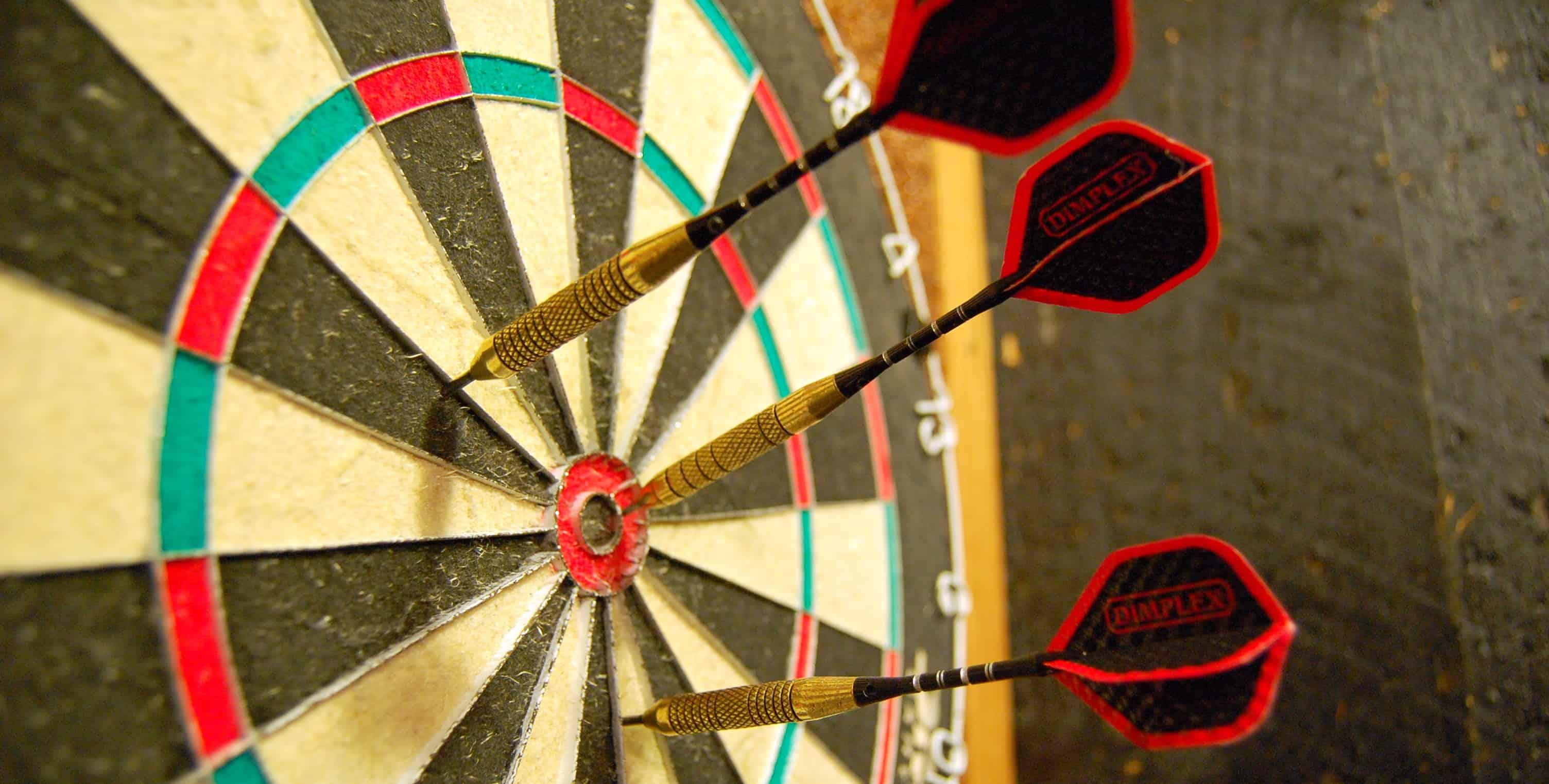 Darts Hitting Bullseye